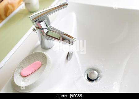 Working mixer tap in the bathroom closeup - Stock Photo