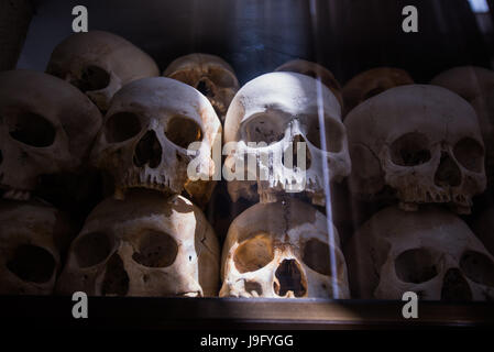 Human bones and skulls in tomb in Cambodia death fields - Stock Photo