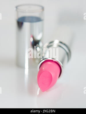 Pink lipstick in a silver tube - Stock Photo