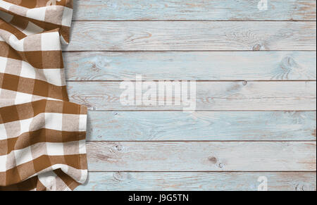 brown picnic cloth on blue wood table - Stock Photo