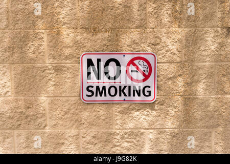 No Smoking Sign On A Wall - Stock Photo
