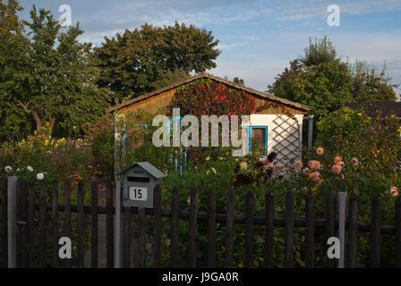 Allotment garden in Berlin. Often called Schrebergarten (German) or simply an allotment, or a community garden. - Stock Photo