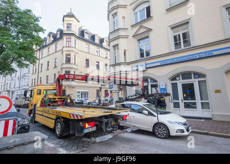 Germany, Bavaria, Munich, Illegally Parked Car being Removed - Stock Photo