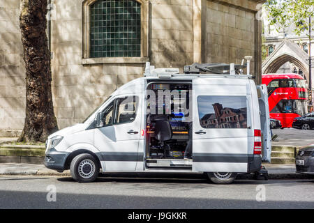 Television (TV) outside broadcast (OB) vans outside Royal Courts of Justice, London, UK - Stock Photo