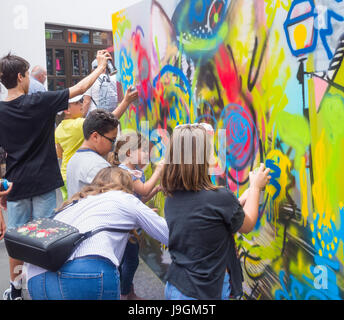 Graffiti lesson for children at street art event in Spain - Stock Photo