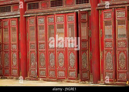 Red doors in the Forbidden Purple City, historic Hue Citadel (Imperial City), Hue, North Central Coast, Vietnam - Stock Photo