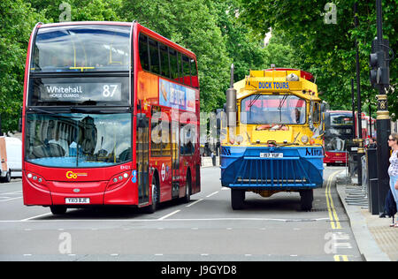 London, England, UK. Double decker bus and a Duck Tours WW2 amphibious vehicle in Whitehall. DUKW ( as Duck) is - Stock Photo