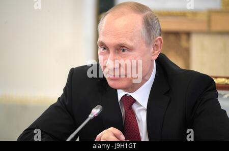 Russian President Vladimir Putin answers questions during the annual meeting with international news organization - Stock Photo