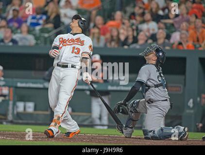 Baltimore, Us. 31st May, 2017. Baltimore Orioles third baseman Manny Machado (13) and New York Yankees catcher Austin - Stock Photo