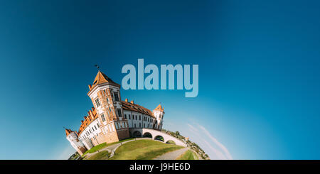 Mir, Belarus. View Of Old Towers Of Mir Castle Complex On Blue Sunny Sky Background. UNESCO Heritage. Famous Landmark - Stock Photo