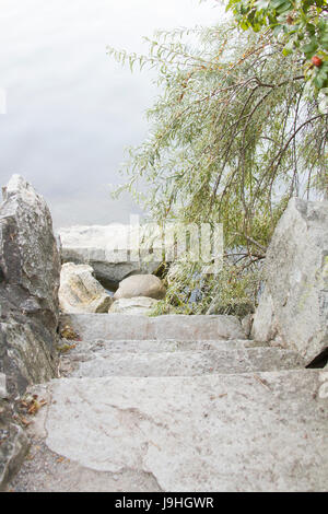 Stone steps leading down to the water - Stock Photo