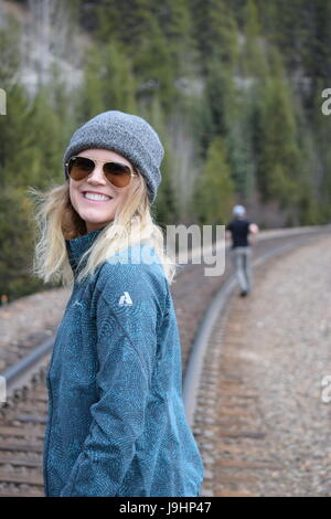 Happy, smiling blonde girl in Banff National Park - Stock Photo