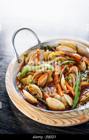 gourmet portuguese clam and vegetable seafood stew in spicy tomato sauce - Stock Photo