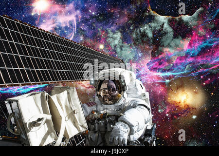 International Space Station and astronaut in outer space over the planet Earth. - Stock Photo