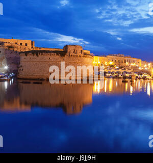 Old Town with fort, city wall and harbour, Gallipoli, province of Lecce, Salento peninsula, Apulia, Italy - Stock Photo