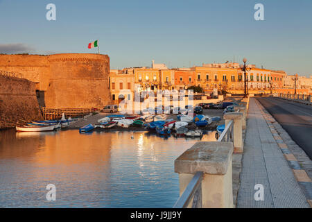Old Town with fort with sunrise, Gallipoli, province of Lecce, Salento peninsula, Apulia, Italy - Stock Photo