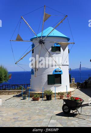 Greek traditional windmill on Skinari Cape, Zakynthos island, Greece - Stock Photo