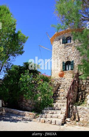 Greek traditional old windmill on Skinari Cape, Zakynthos island, Greece - Stock Photo