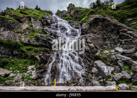 Capra (Goat) Waterfall seen from Transfagarasan Road (DN7C) crossing the southern section of the Carpathian Mountains - Stock Photo