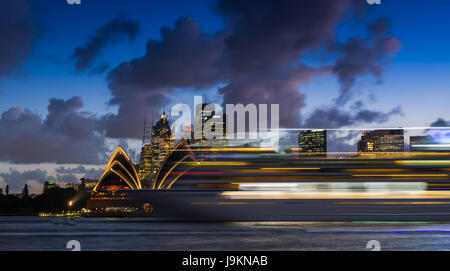 A large cruise ship passes Sydney Opera House. Sydney, New South Wales, Australia. - Stock Photo