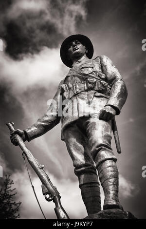 War Memorial statue in bronze of Great War King's Royal Rifle Corps Infantryman at Winchester cathedral, Winchester, - Stock Photo