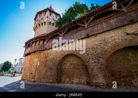 Old walls and Carpenter's Tower (Turnul Dulgherilor) on a Strada Cetatii (Castle or Fortress Street) in Sibiu city - Stock Photo