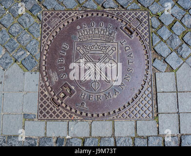 Manhole cover celebrating European Capital of Culture 2007 award in Sibiu city of Transylvania region, Romania - Stock Photo