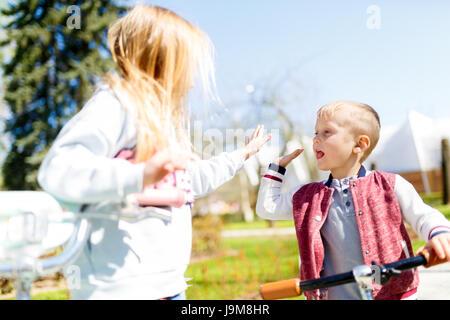 Boy with girl doing handshake - Stock Photo