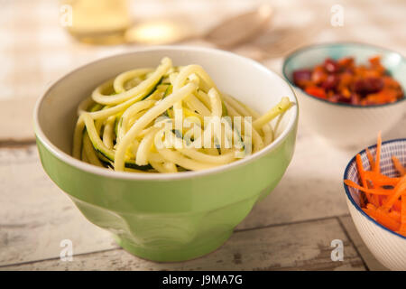 Courgette Spaghetti in a green Bowl - Stock Photo
