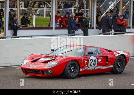1967 Ford GT40 with driver Richard Meins on the grid for the Alan Mann Trophy race at the Goodwood GRRC 74th Members - Stock Photo