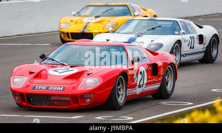 1966 Ford GT40 with driver Marc Devis on the grid for the Alan Mann Trophy race, Goodwood GRRC 74th Members Meeting, - Stock Photo
