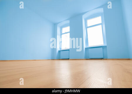 empty apartment room sky blue colored walls Stock Photo Royalty