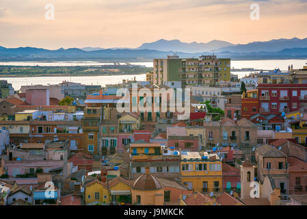 Cagliari old town, view of Cagliari old town at dusk with the city's lagoon in the distance, Sardinia. - Stock Photo