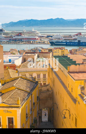 Cagliari old town, view of the city's old town with the port and ferry ships in the distance, Sardinia. - Stock Photo