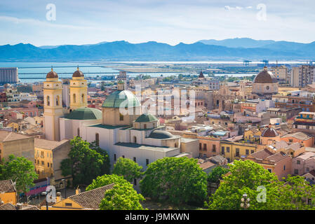 Cagliari Sardinia cityscape, view of the city's old town with the Sant'Anna church in the foreground, Sardinia. - Stock Photo