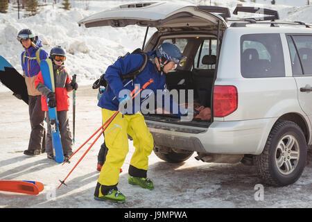 Family preparing for ski during winter - Stock Photo