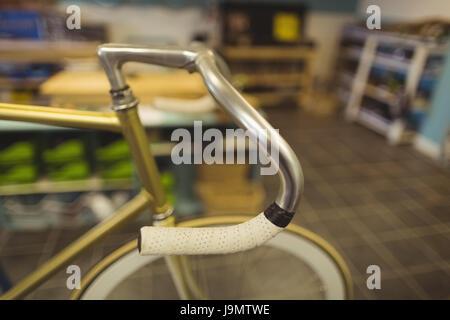 Close up vintage bicycle handlebar at workshop - Stock Photo