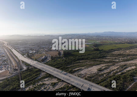 Aerial view of the 101 Freeway crossing the Santa Clara River in Ventura County, California. - Stock Photo