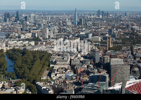 Aerial view looking south east across the city from Buckingham Palace at the London skyline and famous landmarks. - Stock Photo