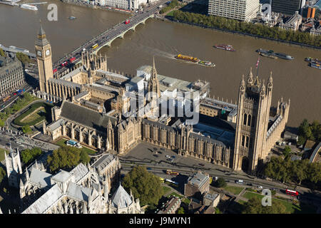 Aerial view of The Palace of Westminster currently covered in scaffolding undergoing repairs. Commonly known as - Stock Photo