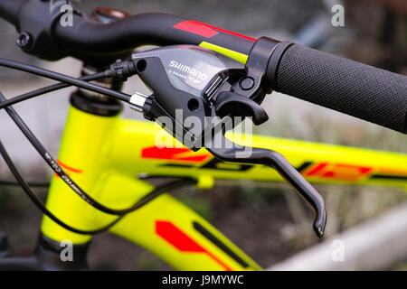 Tambov, Russian Federation - May 07, 2017 Close-up of handlebars with Shimano brake lever. - Stock Photo