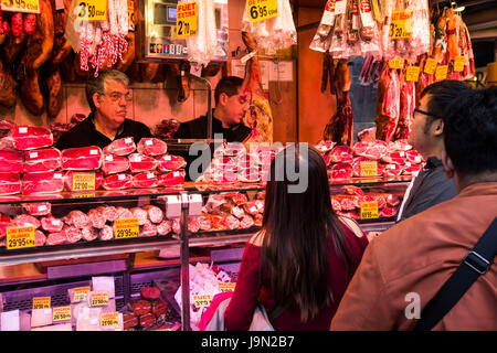 Barcelona's cavernous La Boqueria market is famous for its Jamon Iberico, arguably the world's best tasting ham, - Stock Photo