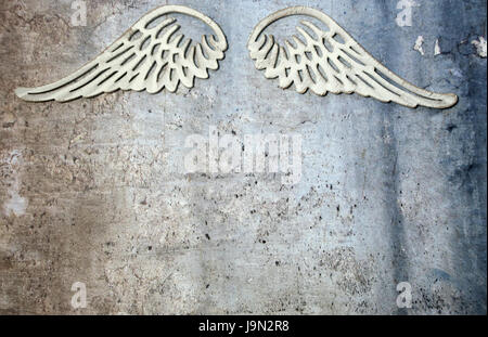 Angel wings on metal background - Stock Photo
