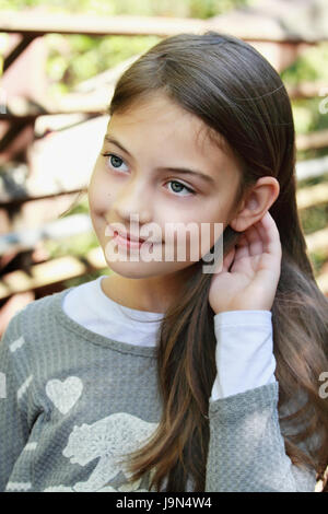 Young pre-teen kid with long hair. - Stock Photo