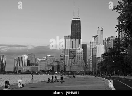 Looking south to downtown Chicago on a summer evening from the jogging path in the Gold Coast neighborhood. - Stock Photo