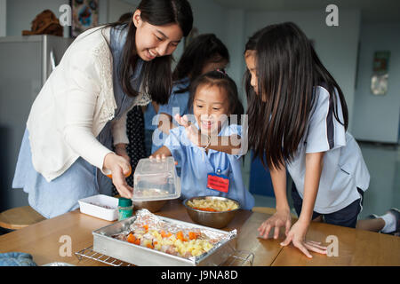 Bangkok, Thailand - November 23, 2012 : in a college in Bangkok Thailand. Young students take an introductory course - Stock Photo
