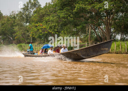 A motor boat carrying passengers on Inle Lake, Myanmar. - Stock Photo
