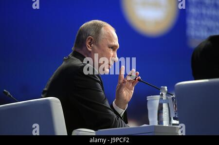 Russian President Vladimir Putin answers questions during the St. Petersburg International Economic Forum June 2, - Stock Photo