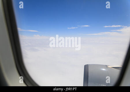 Looking through window aircraft during flight in wing with a blue sky - Travel concept - Stock Photo
