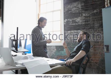 Creative businessmen talking in office - Stock Photo
